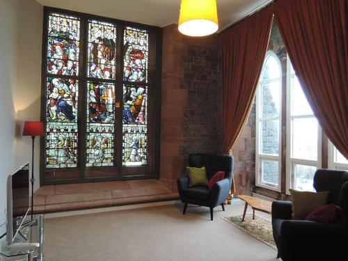 living room with stained glass window