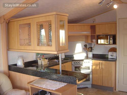 Full size oven and fridge freezer - well equipped