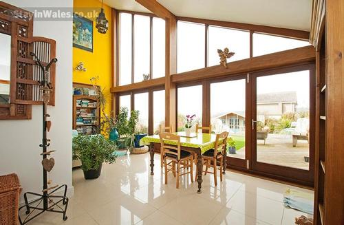 sun room overlooking the sea and riollin