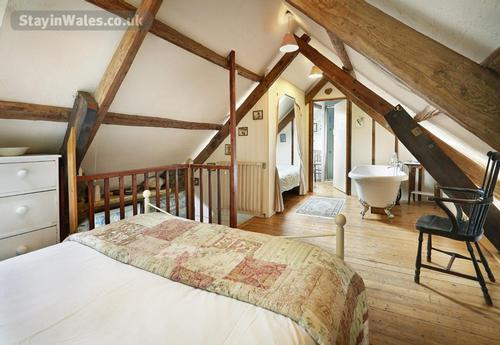 kingsize bed under the beautiful beams