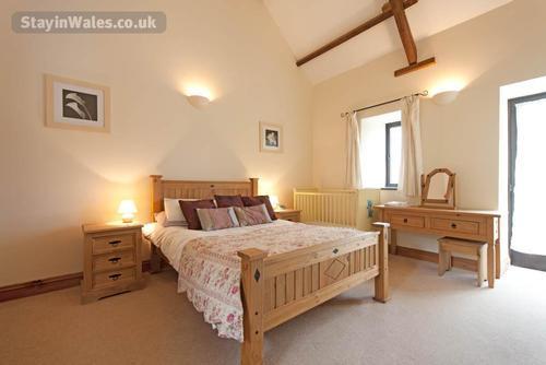 Ground floor double bedroom with cot