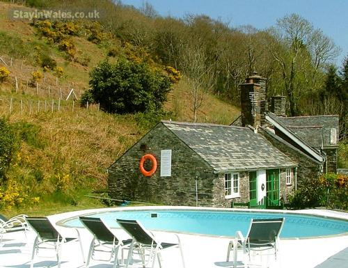 swimming pool adjacent to cottage