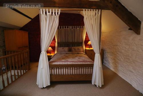 the four-poster king-size bed