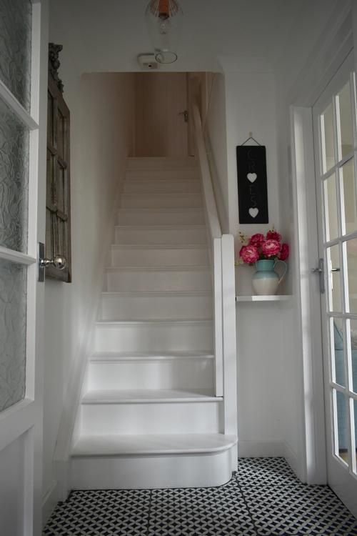 Painted wooden stairs and tiled floor