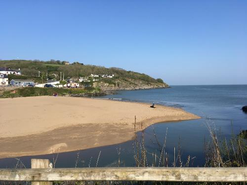 Aberporth's sandy beach at high tide