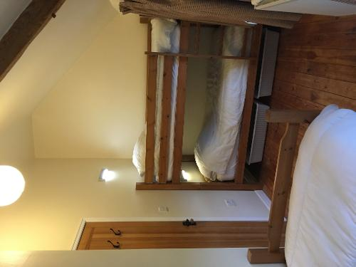 Upstairs bedroom sleep 3 with a bunk bed and a sin