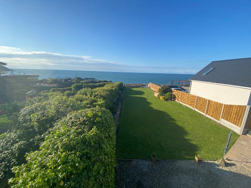 Private enclosed rear garden overlooking the sea
