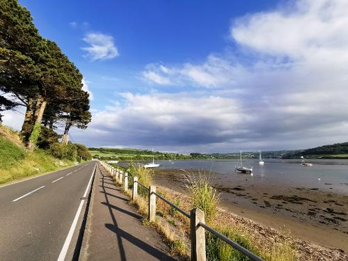 Road and footpath to Gwbert at low tide