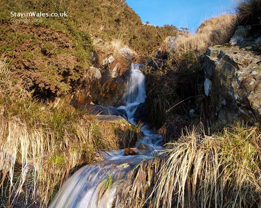 Mountain stream running into Claerwen Reservoir